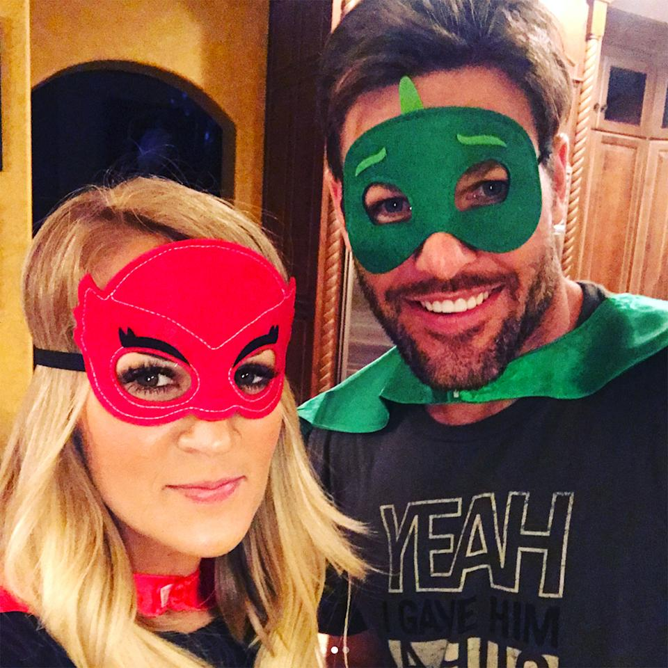 """<p>Mask off! The country singer and her athlete-husband dress in their best when <a rel=""""nofollow"""">prepping son Isaiah for bed</a>.</p>"""