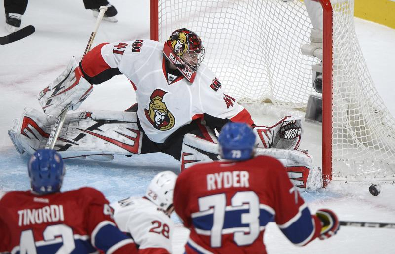 Ottawa Senators goalie Craig Anderson makes a save against Montreal Canadiens' Michael Ryder (73) during the first period of Game 5 first round NHL hockey Stanley Cup playoff series action in Montreal, Thursday, May 9, 2013. (AP Photo/The Canadian Press, Graham Hughes)