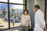 Dr. William Sterett, right, with Vail-Summit Orthopedics talks with Sheika Gramshammer in the new Vail-Summit Orthopedics room on the opening of the new facility, in the new East Wing of Vail Health Hospital, Monday, Nov. 30, 2020, in Vail, Colo. (Chris Dillmann/Vail Daily via AP)