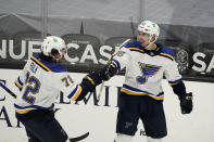 St. Louis Blues' Jordan Kyrou, right, celebrates his second goal of an NHL hockey game with Justin Faulk during the first period against the Anaheim Ducks, Saturday, Jan. 30, 2021, in Anaheim, Calif. (AP Photo/Jae C. Hong)