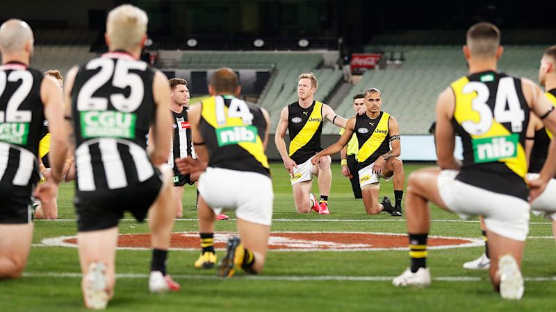 AFL players, pictured here taking a knee to support the Black Lives Matter movement.