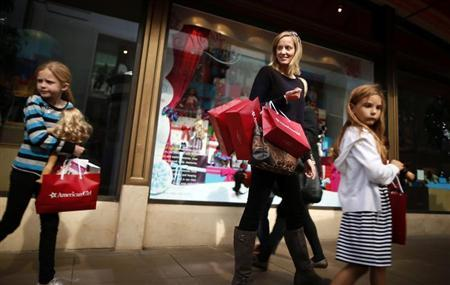 People shop at The Grove mall in Los Angeles