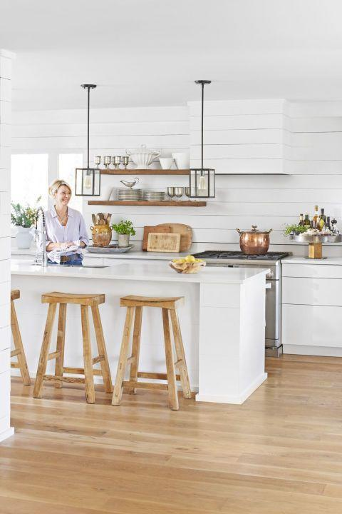 """<p>In <a href=""""https://www.countryliving.com/home-design/house-tours/g4058/alabama-farmhouse-renovation/"""" rel=""""nofollow noopener"""" target=""""_blank"""" data-ylk=""""slk:this Alabama farmhouse kitchen"""" class=""""link rapid-noclick-resp"""">this Alabama farmhouse kitchen</a>, the homeowners opened up their suburban cookie cutter kitchen with lighter, brighter accents. Natural wood accents—open shelves, bread boards, barstools, and floors—bring just the right amount of warmth to the now-open space.</p>"""