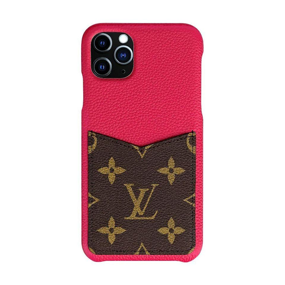 """<p><strong>Louis Vuitton</strong></p><p>louisvuitton.com</p><p><strong>$450.00</strong></p><p><a href=""""https://us.louisvuitton.com/eng-us/products/iphone-11-pro-bumper-monogram-nvprod1980006v#M69095"""" rel=""""nofollow noopener"""" target=""""_blank"""" data-ylk=""""slk:Shop Now"""" class=""""link rapid-noclick-resp"""">Shop Now</a></p><p>The Louis Vuitton bumper for the iPhone 11 Pro is crafted using high-quality leather and displays the brand's iconic monogram canvas. </p><p>This luxe accessory has a small back pocket with a space for notes or bills. This iPhone wallet case offers style than storage space.</p><p>You can order the bumper case with a scarlet or black leather finish. The case is also available for the <a href=""""https://us.louisvuitton.com/eng-us/products/iphone-11-pro-max-bumper-monogram-nvprod2000118v"""" rel=""""nofollow noopener"""" target=""""_blank"""" data-ylk=""""slk:iPhone 11 Pro Max"""" class=""""link rapid-noclick-resp"""">iPhone 11 Pro Max</a>, as well as the iPhone XS and iPhone XS Max.</p>"""
