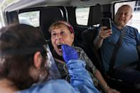 In Israel, where this woman is being tested for Covid-19, the government has authorized booster shots for those over the age of 60