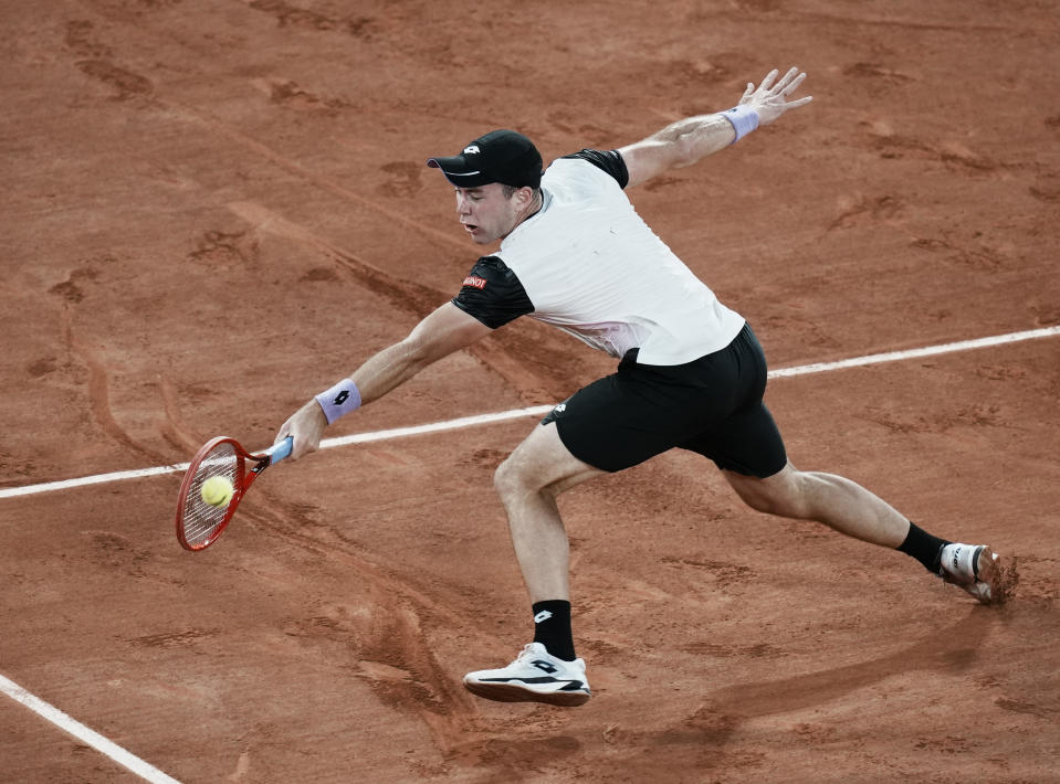 Germany's Dominik Koepfer plays a return to Switzerland's Roger Federer during their third round match on day 7, of the French Open tennis tournament at Roland Garros in Paris, France, Saturday, June 5, 2021. (AP Photo/Thibault Camus)
