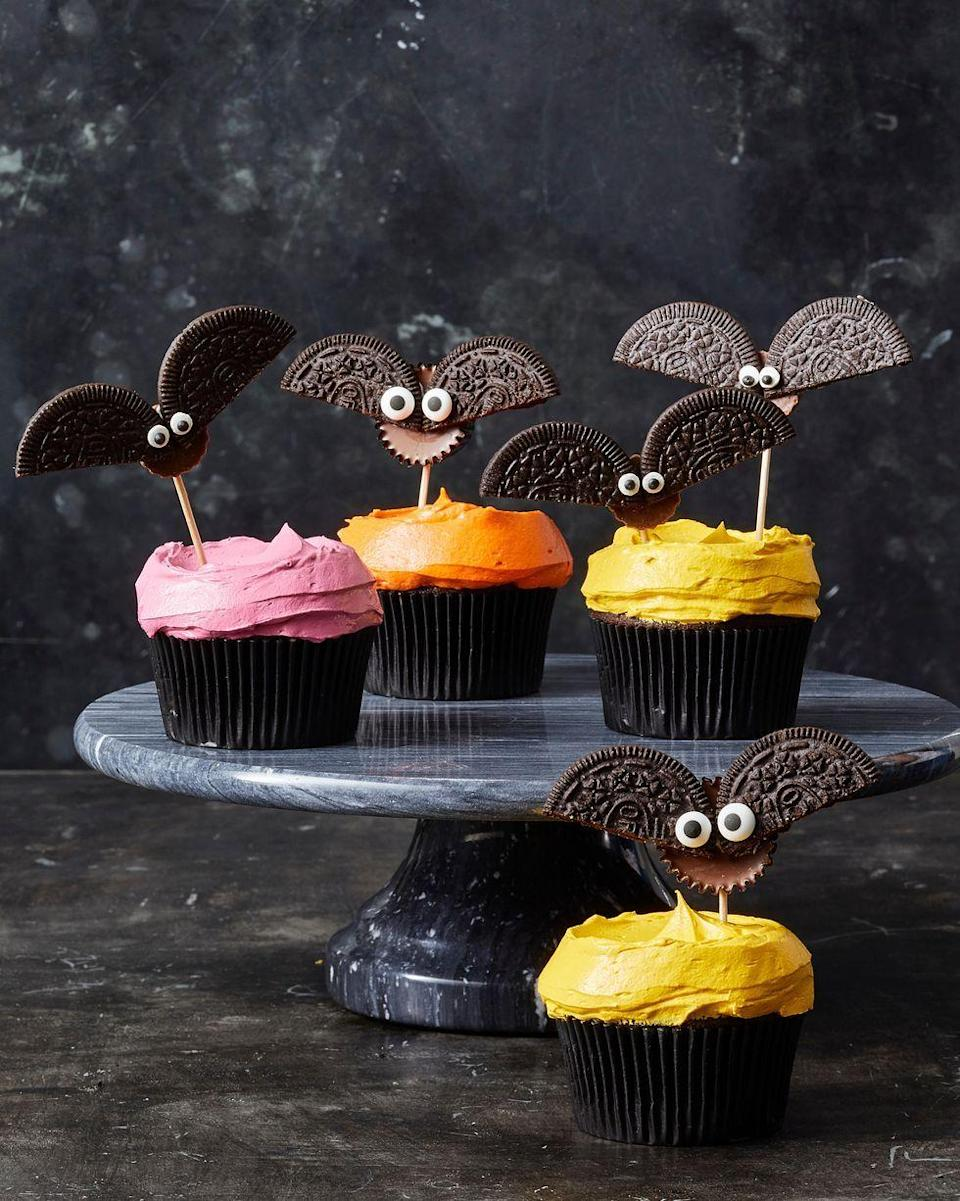 """<p>For an easy (and edible!) craft idea, make cute bats out of Oreos and peanut butter cups. </p><p><em><a href=""""https://www.goodhousekeeping.com/food-recipes/party-ideas/a28593120/cookie-bat-cupcakes-recipe/"""" rel=""""nofollow noopener"""" target=""""_blank"""" data-ylk=""""slk:Get the recipe for Cookie Bat Cupcakes »"""" class=""""link rapid-noclick-resp"""">Get the recipe for Cookie Bat Cupcakes »</a></em></p><p><strong>RELATED: </strong><a href=""""https://www.goodhousekeeping.com/holidays/halloween-ideas/g22062770/halloween-crafts-for-kids/"""" rel=""""nofollow noopener"""" target=""""_blank"""" data-ylk=""""slk:Fun Halloween Crafts for Kids That Are Perfect for Family Bonding Time"""" class=""""link rapid-noclick-resp"""">Fun Halloween Crafts for Kids That Are Perfect for Family Bonding Time</a></p>"""