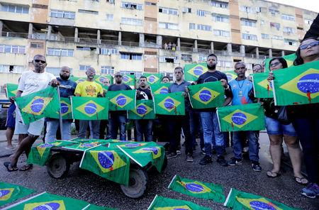 FILE PHOTO: Residents demonstrate in memory of Evaldo Rosa dos Santos, who was killed during a military operation, in Rio de Janeiro, Brazil April 10, 2019. REUTERS/Sergio Moraes/File Photo