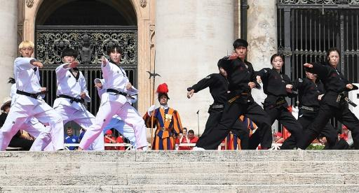 The martial arts athletes, half in white and half in black uniforms, performed for the pope in Saint Peter's Square