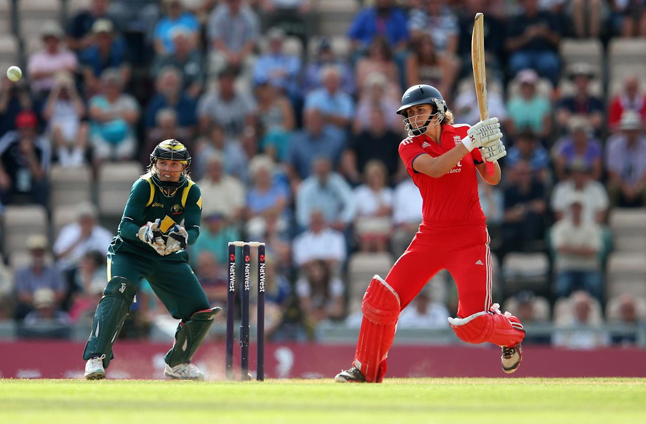 SOUTHAMPTON, ENGLAND - AUGUST 29:   Natalie Sciver of England bats as Jodie Fields of Australia keeps wicket during the 2nd NatWest T20 match between England Women and Australia Women at Ageas Bowl on August 29, 2013 in Southampton, England.  (Photo by Julian Finney/Getty Images)