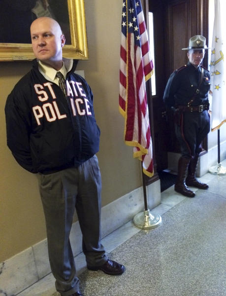Rhode Island state police officers stand outside the office of House Speaker Gordon Fox Friday, March 21, 2014 at the Statehouse in Providence, R.I. A U.S. attorney's office spokesman said his office, the FBI, IRS and state police are engaged in a law enforcement action, but would not comment whether the Democratic House speaker was being investigated. (AP Photo/Erika Niedowski)