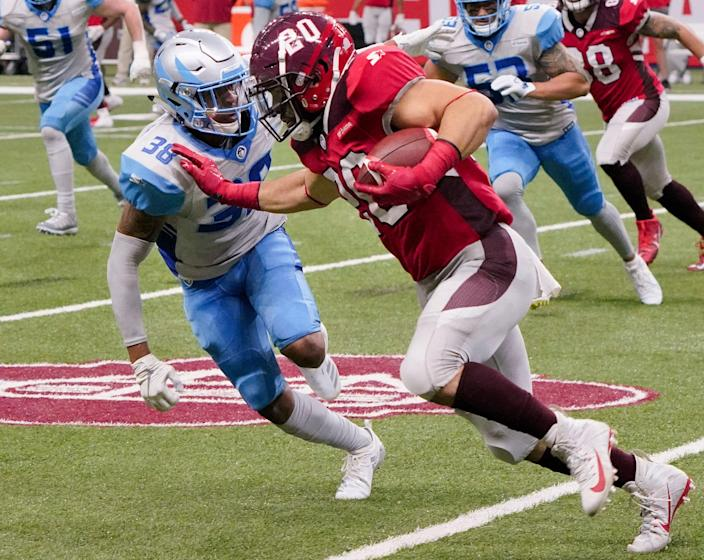 San Antonio Commanders' Kenneth Farrow II (20) attempts to evade Salt Lake Stallions' Henre' Toliver during the second half of an AAF football game, Saturday, March 23, 2019, at the Alamodome in San Antonio. San Antonio won 19-15. (AP Photo/Darren Abate)