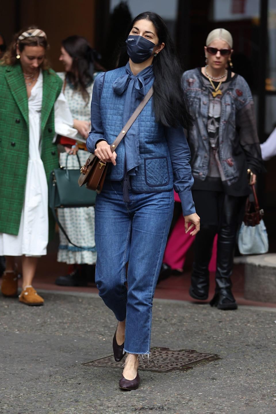 """This show-goer's super-cute padded gilet is an example of the texture trend in action.<span class=""""copyright"""">Photo Courtesy of Neil Mockford/Getty Images.</span>"""