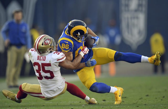 <p>Los Angeles Rams tight end Derek Carrier, right, is tackled by San Francisco 49ers strong safety Eric Reid during the second half of an NFL football game, Sunday, Dec. 31, 2017, in Los Angeles. (AP Photo/Mark J. Terrill) </p>