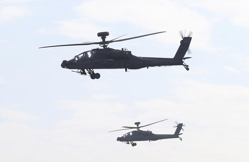 AH-64E Apache attack helicopters which are equipped with AN/APG-78 Longbow Fire Control Radar and purchased from the U.S. take part during a commissioning ceremony at the Tainan military base