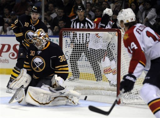 Buffalo Sabres' defenseman Christian Ehrhoff, (10), of Germany, and goalie Ryan Miller (30) react to a goal by Florida Panthers' George Parros (not shown) while Carolina Panther's Tomas Fleischmann, (14), of the Czech Republic, looks on during the second period of an NHL hockey game in Buffalo, N.Y., Sunday, Feb. 3, 2013. (AP Photo/Gary Wiepert)
