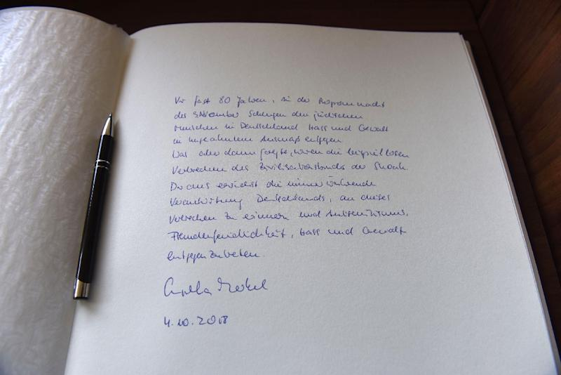 "A close-up of the message Chancellor Angela Merkel wrote in the guest book of the Yad Vashem Holocaust Museum referring to the ""everlasting everlasting responsibility of Germany to remember this crime and to oppose anti-Semitism"" (AFP Photo/DEBBIE HILL)"
