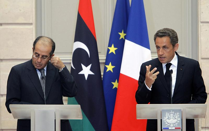 France's President Nicolas Sarkozy, rigth, reacts with  the head of Libya's opposition government Mahmoud Jibril during at their meeting at the Elysee Palace in Paris. Wednesday, Aug. 24, 2011. (AP Photo/Jacques Brinon)