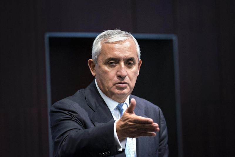 President of Guatemala Otto Perez Molina speaks during an event at the Center for Strategic and International Studies on July 24, 2014 in Washington, DC (AFP Photo/Brendan Smialowski)