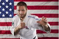 Judo athlete Travis Stevens poses for a portrait during the 2012 U.S. Olympic Team Media Summit in Dallas, May 13, 2012.