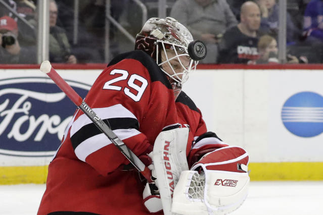 New Jersey Devils goaltender MacKenzie Blackwood blocks a shot from the New York Rangers during the third period of an NHL hockey game, Monday, April 1, 2019, in Newark, N.J. The Devils won 4-2. (AP Photo/Julio Cortez)