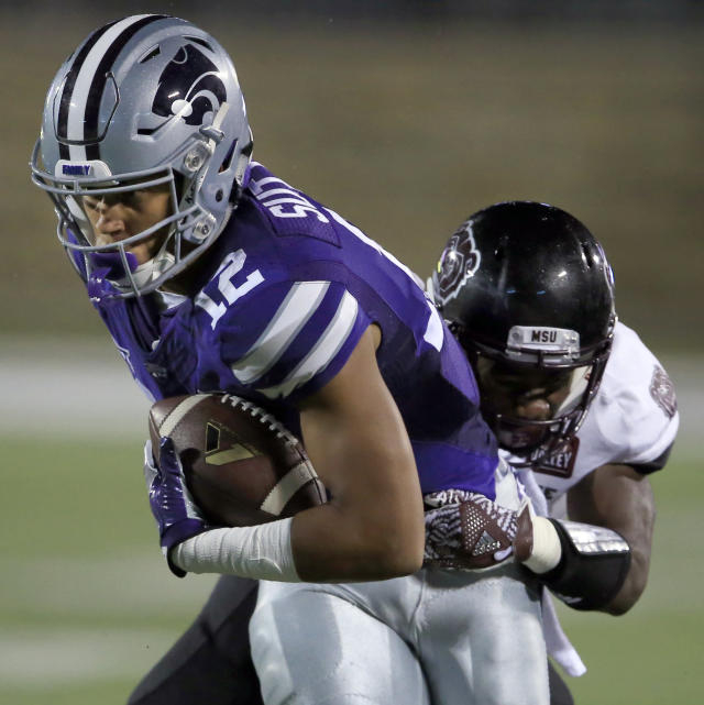 FILE - In this Sept. 24, 2016, file photo, Kansas State wide receiver Corey Sutton (12) is tackled by Missouri State cornerback Matt Rush during the first half of an NCAA college football game in Manhattan, Kan. College athletes will no longer need permission from their coach or school to transfer and receive financial aid from another school. The NCAA Division I Council approved the change Wednesday, June 13, 2018. It takes effect Oct. 15. Standoffs between athletes and coaches over transfers have often led to embarrassing results for schools standing in the way of player who wishes to leave. Last spring at Kansas State, reserve receiver Corey Sutton said he was blocked him from transferring to 35 schools by coach Bill Snyder before the school finally relented after public pressure. (AP Photo/Orlin Wagner, FIle)