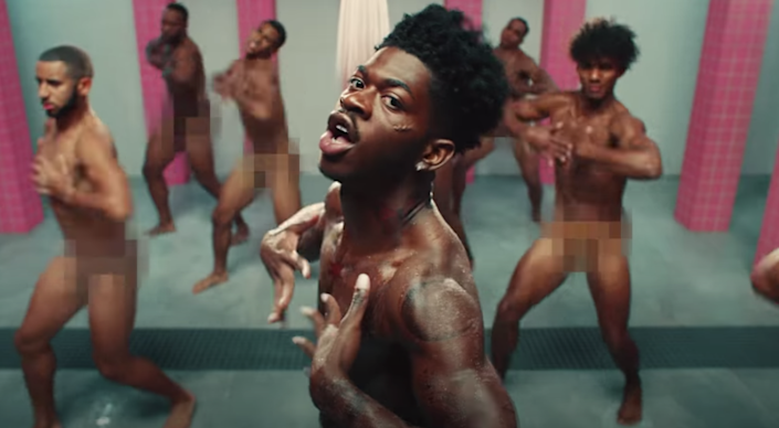 Lil Nas X and his background dancers dancing nude in a clip from his 'Industry Baby' music video