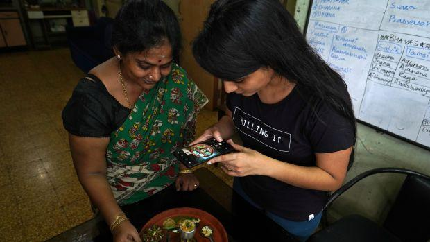 Geetha Sridhar makes a video on her miniature cooking with her daughter Sarada Sridhar, in Mumbai