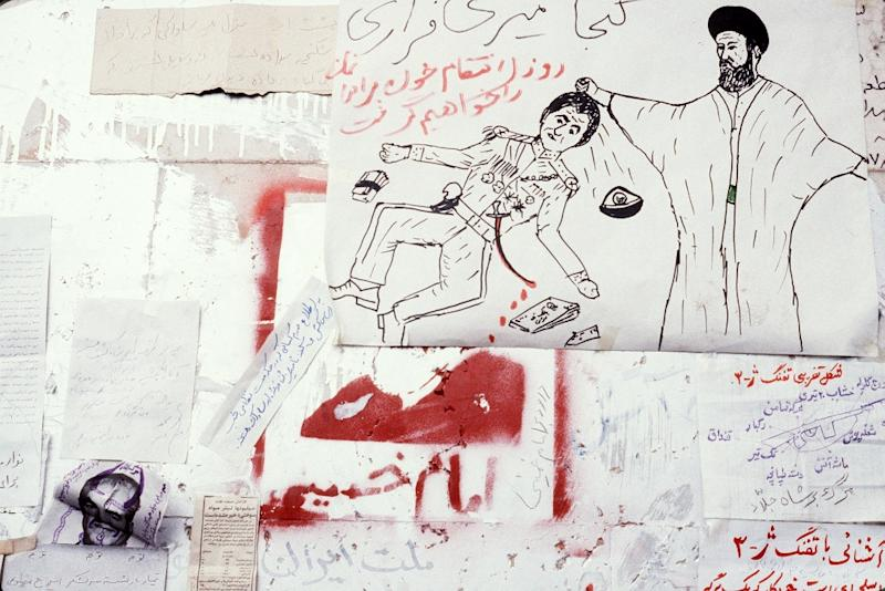Anti-shah graffiti in Tehran on January 13, 1979, three days before Iran's last monarch goes into exile (AFP Photo/GABRIEL DUVAL)