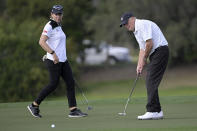 Annika Sorenstam, left, of Sweden, watches as her father Tom Sorenstam sinks his putt on the 14th green during the first round of the PNC Championship golf tournament, Saturday, Dec. 19, 2020, in Orlando, Fla. (AP Photo/Phelan M. Ebenhack)