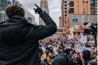 <p>Local organizer Brandyn Tulloch speaks to the crowd during a demonstration on April 19 in Minneapolis.</p>