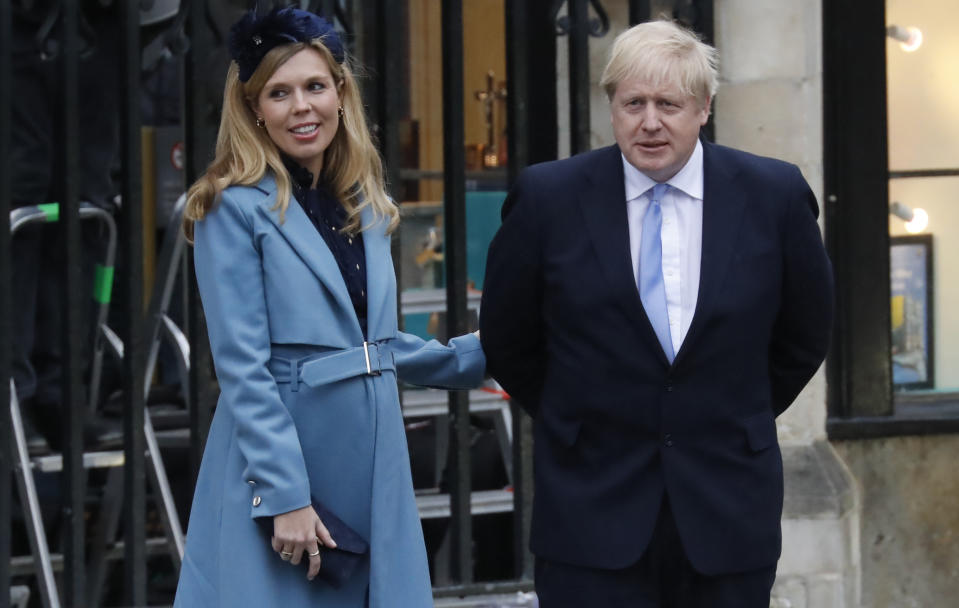 Britain's Prime Minister Boris Johnson (R) with his partner Carrie Symonds leave after attending the annual Commonwealth Service at Westminster Abbey in London on March 09, 2020. - Britain's Queen Elizabeth II has been the Head of the Commonwealth throughout her reign. Organised by the Royal Commonwealth Society, the Service is the largest annual inter-faith gathering in the United Kingdom. (Photo by Tolga AKMEN / AFP) (Photo by TOLGA AKMEN/AFP via Getty Images)