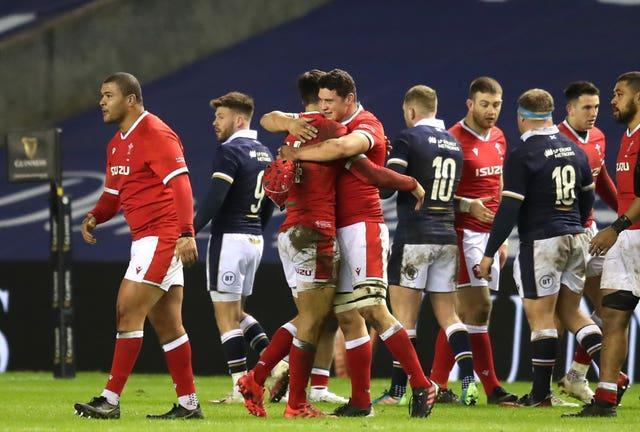 Wales celebrate a tense 25-24 victory over Scotland