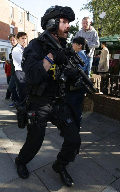 Armed police are on the scene at Parsons Green - Credit: AFP