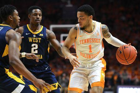 Jan 26, 2019; Knoxville, TN, USA; Tennessee Volunteers guard Lamonte Turner (1) moves the ball against West Virginia Mountaineers forward Derek Culver (1) and guard Brandon Knapper (2) during the second half at Thompson-Boling Arena. Tennessee won 83 to 66. Mandatory Credit: Randy Sartin-USA TODAY Sports