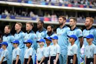 England's players line up for the national anthems. (Photo by Gareth Copley-IDI/IDI via Getty Images)