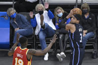 Spectators react as Orlando Magic forward Chuma Okeke (3) catches a pass in front of Atlanta Hawks guard Tony Snell (19) during the second half of an NBA basketball game Wednesday, March 3, 2021, in Orlando, Fla. (AP Photo/Phelan M. Ebenhack)