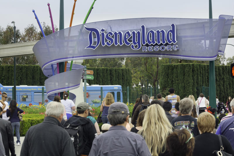 Anaheim, California, USA - April 30, 2013: A large group of people entering the Disneyland Resort in Anaheim, where Disneyland Park and Disney California Adventure Park are located.