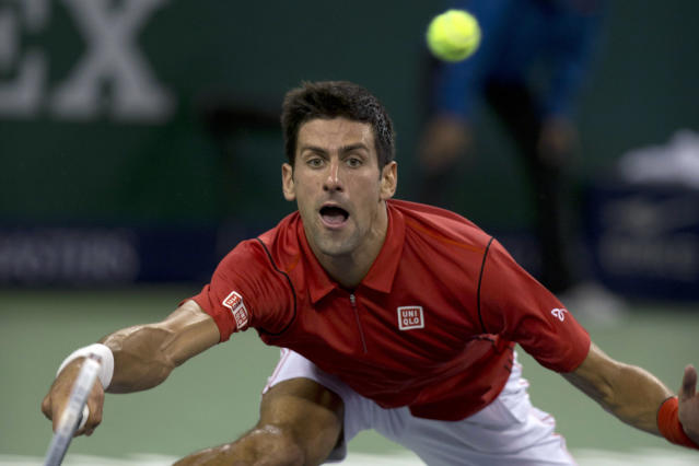 Serbia's Novak Djokovic returns a shot to Argentina's Juan Martin del Potro during their final match at the Shanghai Masters tennis tournament at the Qizhong Forest Sports City Tennis Center in Shanghai, China, Sunday, Oct. 13, 2013. Djokovic won 6-1, 3-6, 7-6 (3). (AP Photo/Ng Han Guan)