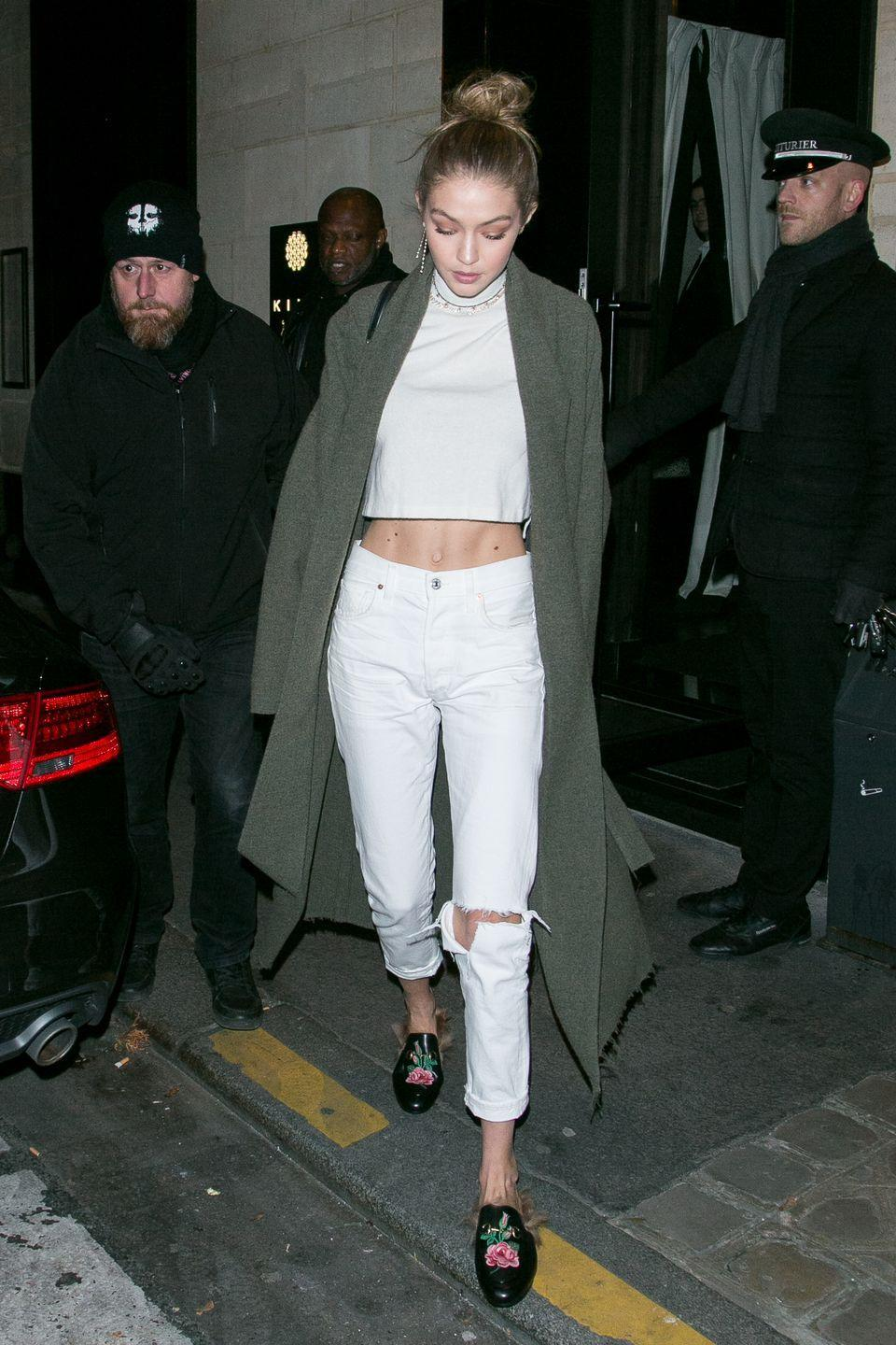 <p>Gigi made all-white look totally wearable with pops of skin and an army green duster jacket. (Related: is there a duster that Gigi <em>doesn't</em> own?)</p>