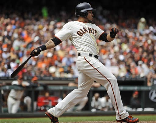 San Francisco Giants' Melky Cabrera swings for an RBI double off Cincinnati Reds' Bronson Arroyo in the fifth inning of a baseball game, Sunday, July 1, 2012, in San Francisco. (AP Photo/Ben Margot)