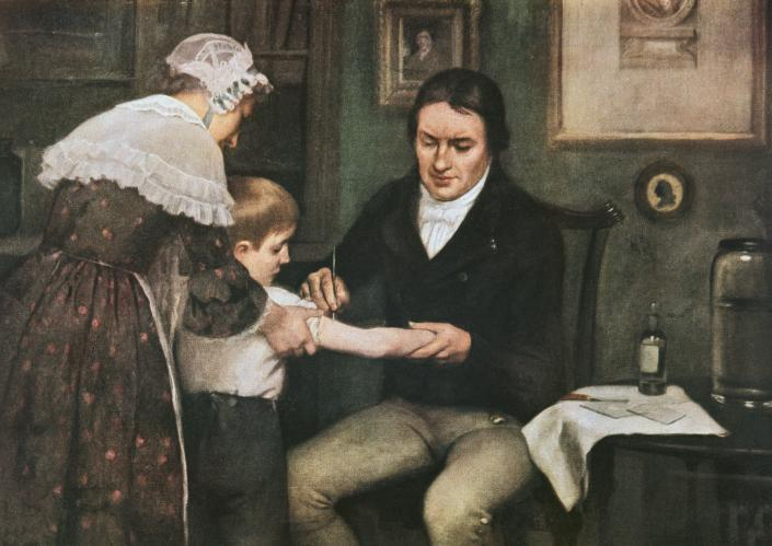 Dr Edward Jenner (1749-1823) performing his first vaccination against smallpox on James Phipps, a boy of eight, May 14, 1796, oil on canvas by Ernest Board (1877-1934), 1920-1930, United Kingdom, 20th century.