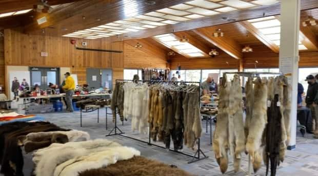 More than 10 vendors set up their tables and racks at the Yukon Trappers Association's spring fur and craft sale this past weekend in Whitehorse. (Chris MacIntyre/CBC - image credit)