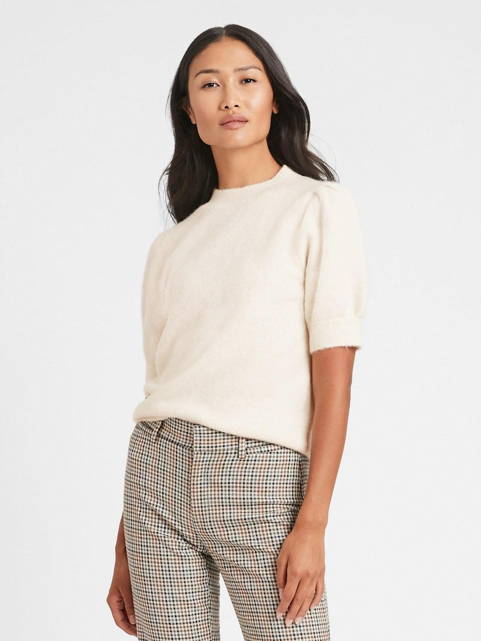 <p>This <span>Puff-Sleeve Sweater Top</span> ($63, originally $80) is a must-have layer in your fall closet.</p>