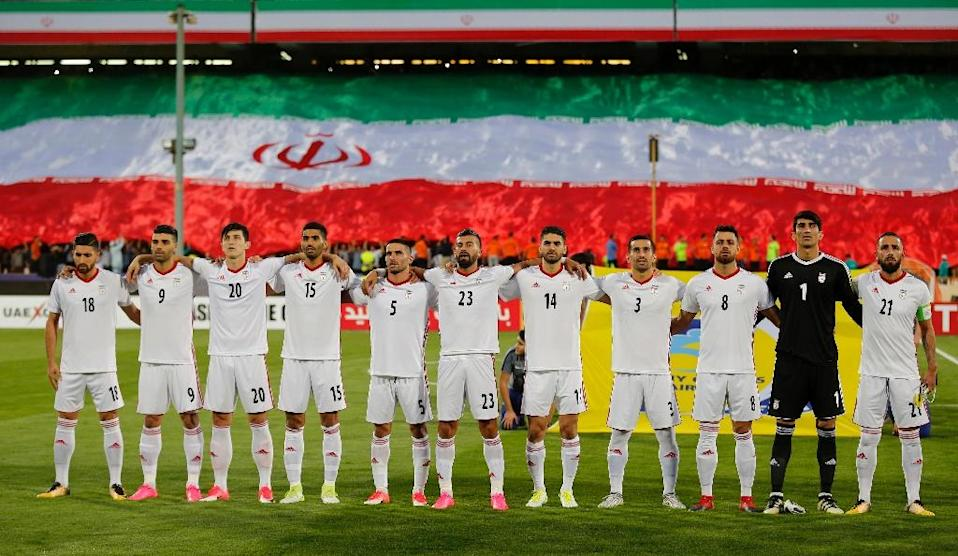 Iranian players stand prior to their FIFA 2018 World Cup qualifier match against Syria, at the Azadi Stadium in Tehran, on September 5, 2017 (AFP Photo/ATTA KENARE)