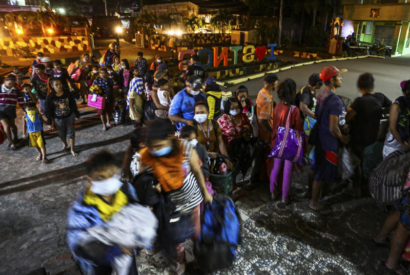 Residents are evacuated to a local school as the Taal volcano continues to erupt in Santo Tomas, Batangas, southern Philippines, Monday January 13, 2020. (AP Photo/Gerrard Carreon)