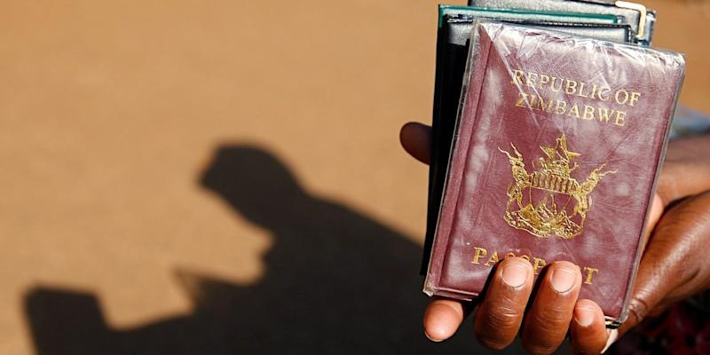 Zimbabwe is so poor that it can't even afford to issue its citizens passports, and locals are turning to Bitcoin in the inflation-ridden country.   Source: REUTERS / Philimon Bulawayo