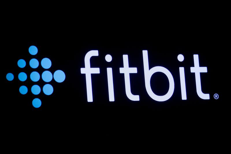 The logo for wearable device maker Fitbit Inc. is displayed on a screen at NYSE floor in New York