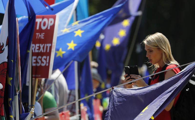 Anti-Brexit protestors in London, Tuesday, July 23, 2019. Brexit champion Boris Johnson was announced Tuesday as winner in the contest to lead Britain's governing Conservative Party, and to become the country's next prime minister. (AP Photo/Frank Augstein)