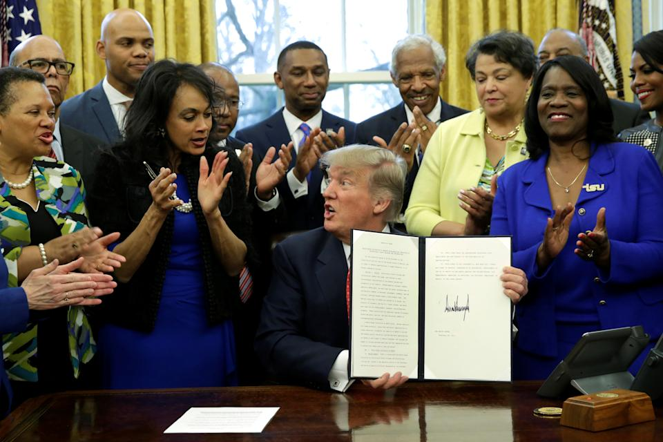 U.S. President Donald Trump shows the signed HBCU executive order in the the Oval Office of the White House, in Washington, DC, U.S. February 28, 2017. REUTERS/Yuri Gripas